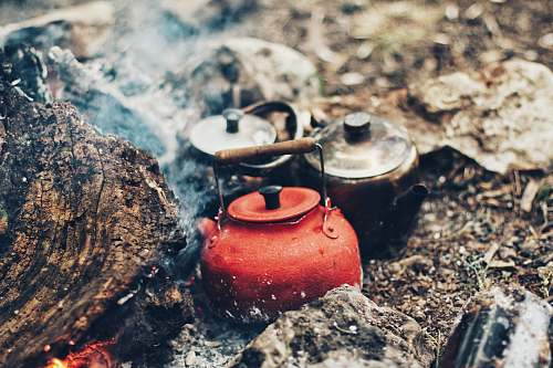 camp three red and gray kettles on charcoals tea kettle
