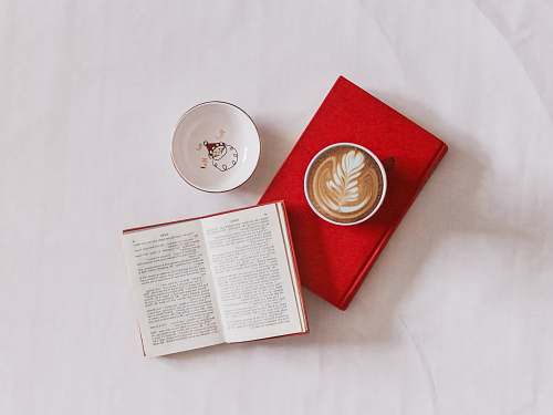 read white ceramic mug reading