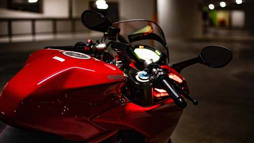 vehicle closeup photography of sports bike on street motorcycle