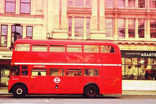 photo bus red double deck bus in front of building vehicle free for commercial use images