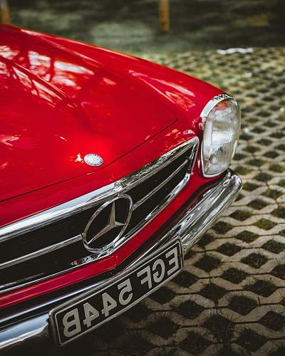 automobile shallow focus photo of red Mercedes-Benz car car