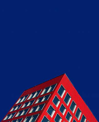 building worm's eyeview of red building zürich