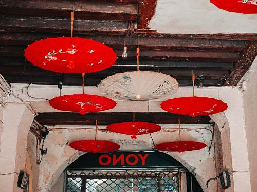 banister red and white opened umbrellas hanging on ceiling handrail