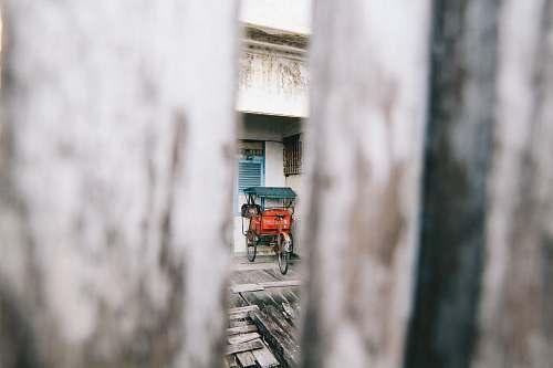 indonesia photo of red rickshaw wagon