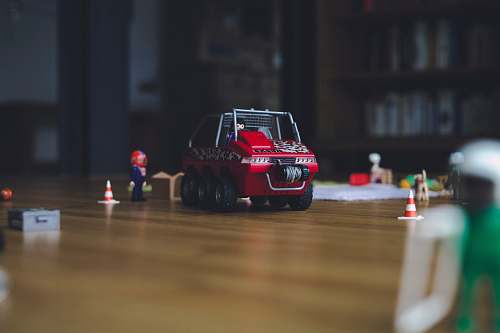car red and black truck toy on floor automobile