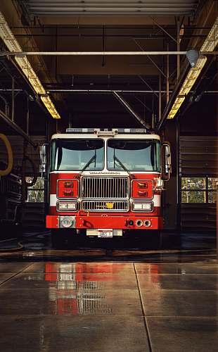 engine red firetruck on garage truck
