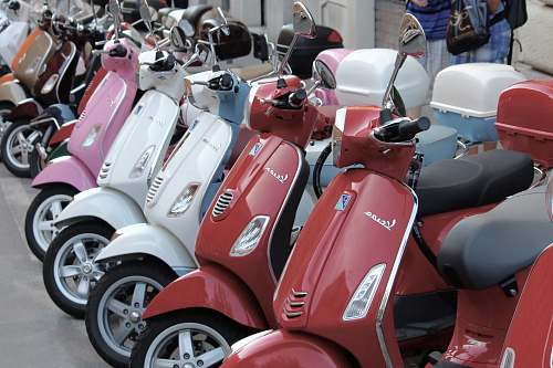 transportation red, white, and pink automatic scooters vespa