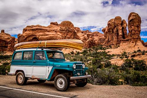 jeep teal and white SUV car