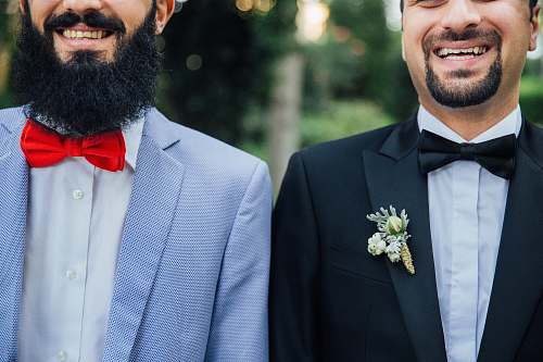 suit two men standing next to each other person