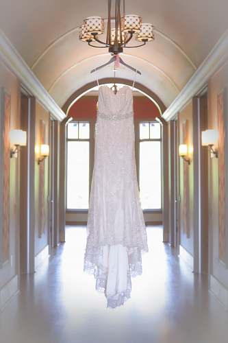 dress white spaghetti strap dress hang on chandelier light