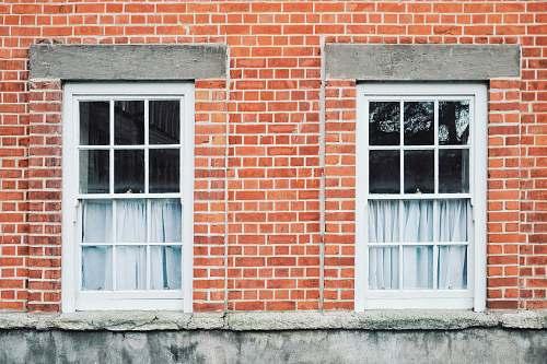 brick two white wooden windowpanes dublin