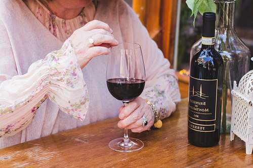 alcohol woman holding a glass of wine on the table drink