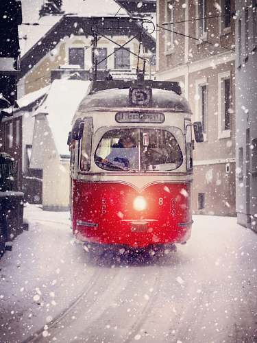 snow white and red cable train during winter outdoors