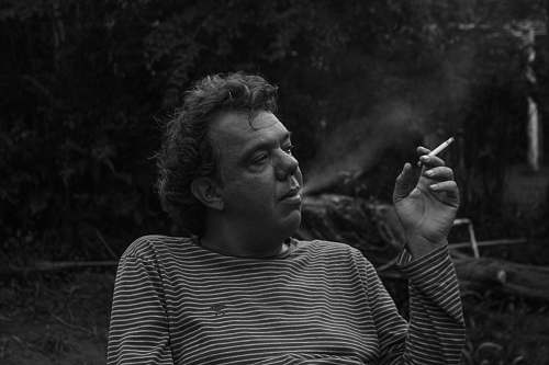 human grayscale photography of man white smoking people