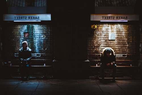 people two men sitting on Baker Street person