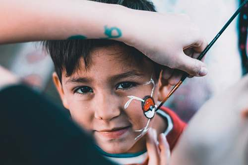 person boy drawn Pokeball on his face human