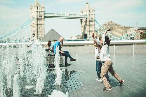 human children playing near fountain person