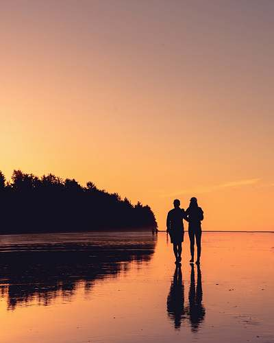human couple standing on body of water person