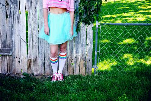 person girl's teal skirt clothing