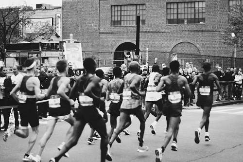 black-and-white grayscale photo of men running on marathon running