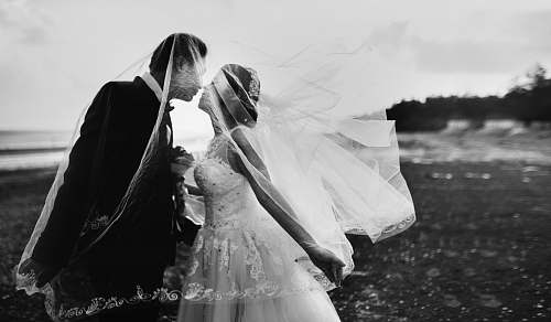black-and-white grayscale shot of bride and groom wedding