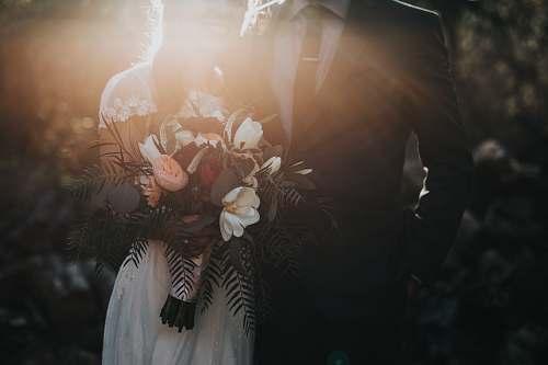 person groom beside bride holding bouquet flowers wedding