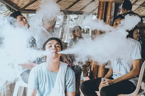 person group of people vaping on gazebo human