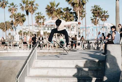 person man doing skateboard trick skateboard