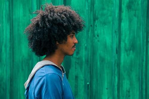 human man facing right near green wall person