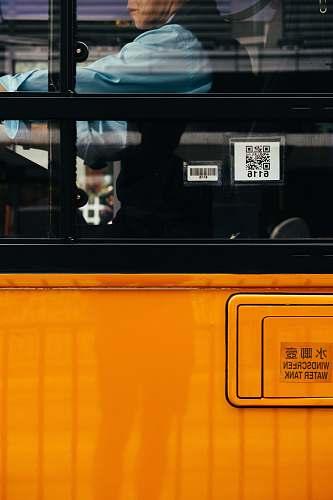 person man inside orange bus human