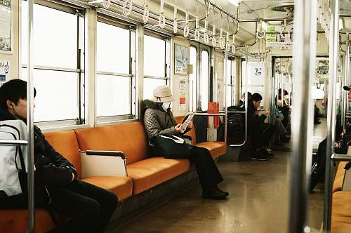 couch man sitting inside the train furniture