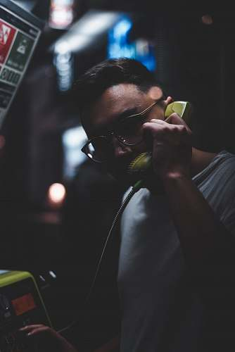 human man standing holding telephone person
