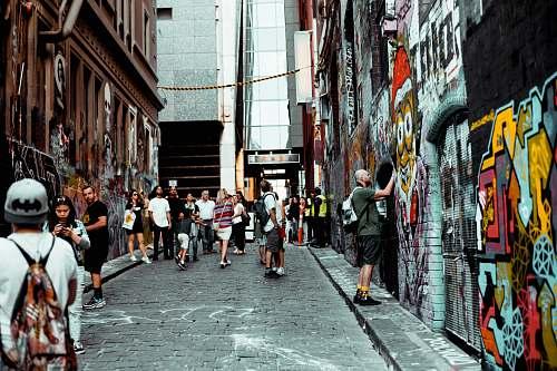 human man standing near concrete building graffiti