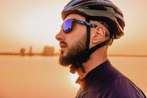 person man wearing black bike helmet human