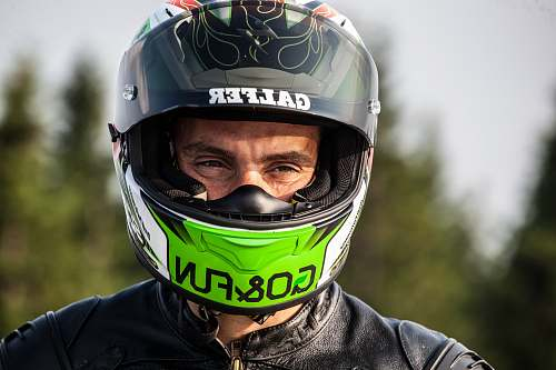 person man wearing black multicolored helmet helmet