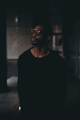 person man wearing black sweatshirt and sunglasses human