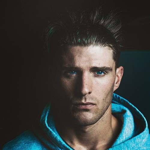 human man wearing blue hoodie person