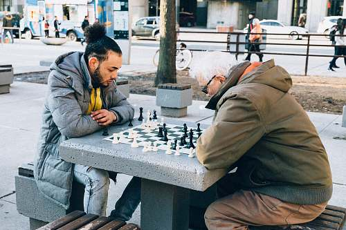 chess people playing chessboard game outdoor game