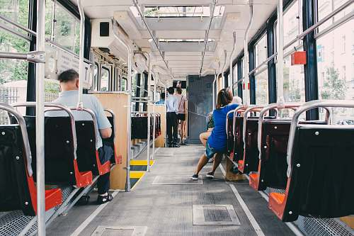 vehicle people riding the bus at daytime transportation