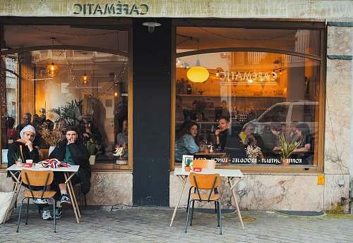 cafe people sitting inside cafe restaurant