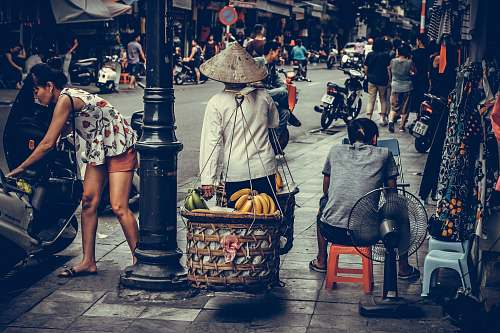 person person carrying fruit baskets human