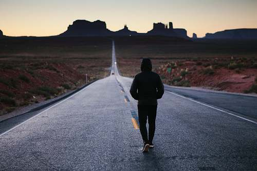 human person walking in the center of the road person