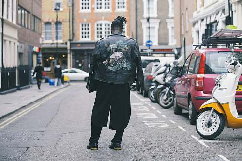 human person wearing black jacket on road person