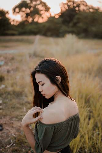person photo of woman wearing off-shoulder top in greenfield human