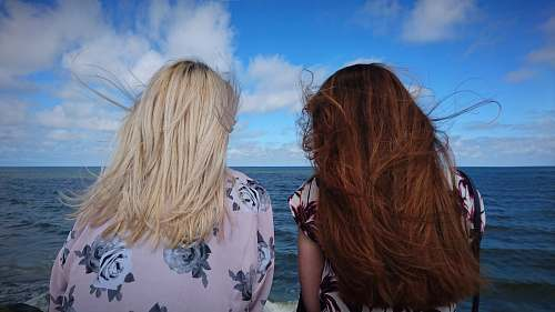 woman photography of two women seeing horizon during daytime blonde