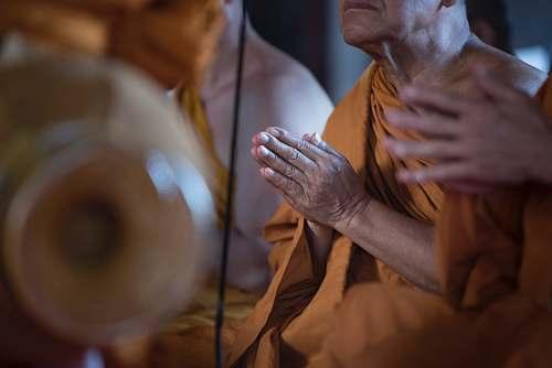 person praying monk human
