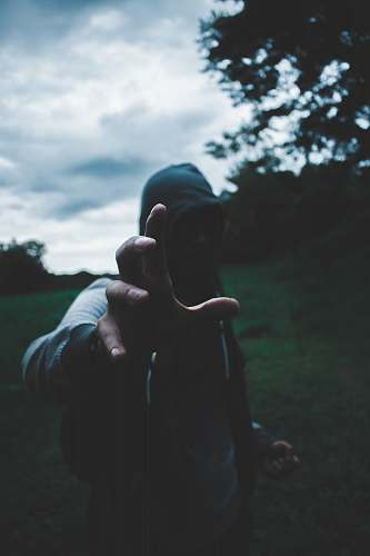 person selective focus photography of man wearing hoodie human