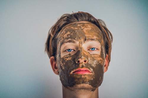 person shallow focus photography of men's muddy face face