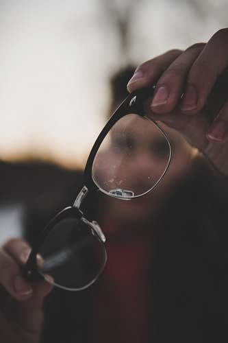 person shallow photography of eyeglasses glasses