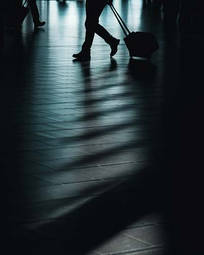 human silhouette of man walking with luggage person
